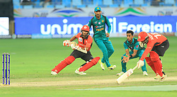 September 16, 2018 - Dubai, United Arab Emirates - Hong Kong cricketers Ehsan Nawaz and  Nadeem Ahmed tries to make the crease to complete a run at the same end as Pakistan crcicketer Hasan Ali tries to catch the ball  during the 2nd cricket match of Asia Cup 2018 between Pakistan  and Hong Kong in Dubai, United Arab Emirates, on September 16, 2018  (Credit Image: © Tharaka Basnayaka/NurPhoto/ZUMA Press)