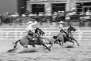 Team roping at Cheyenne Frontier Days in Cheyenne, Wyoming on July 22, 2019.