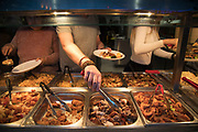 Eat as much as you like Chinese restaurant in Chinatown in London, England, United Kingdom. Many people eat bargain food responsibly and it provides great value for consumers, however concerns over obesity levels in the UK remain, especially with foods containing high levels of fat and sugar. Obesity is a medical condition in which excess body fat has accumulated to the extent that it may have a negative effect on health.