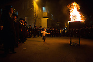 A small boy dancing next to a bonefire in the streets on Mea Shearim during the Lag BaOmer celebratoins in the orthodox distric of Mea Shearim