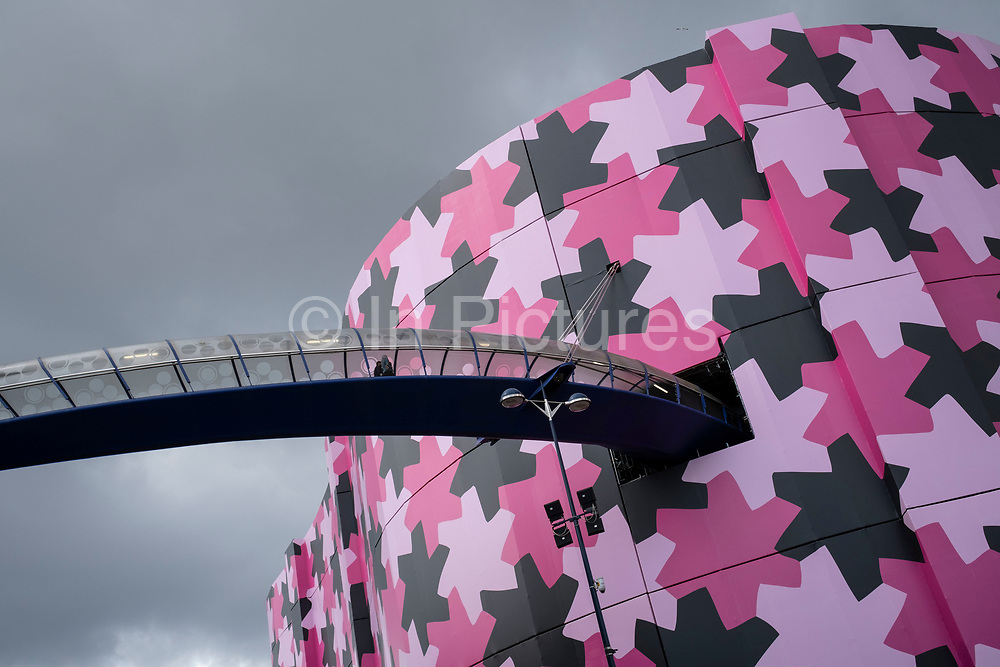 Refurbishment of the iconic Selfridges building in the city centre on 3rd August 2021 in Birmingham, United Kingdom. The exterior of the building has been wrapped in scaffolding and a pink protective covering while it undergoes renovation while the discs are cleaned and repainted in its original colour.