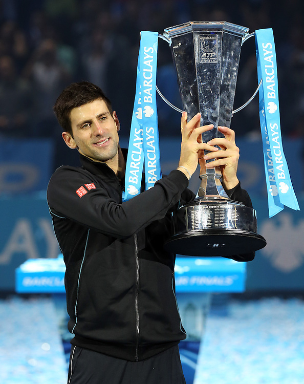 Novak Djokovic (SRB) celebrates with the trophy after his victory over Rafael Nadal (ESP) in their Final match today - Novak Djokovic (SRB) def Rafael Nadal (ESP) 6-3 6-4<br /> <br /> Photo by Rob Newell/CameraSport<br /> <br /> International Tennis - Barclays ATP World Tour Finals - O2 Arena - London - Day 8 -  Monday 11th November 2013<br /> <br /> © CameraSport - 43 Linden Ave. Countesthorpe. Leicester. England. LE8 5PG - Tel: +44 (0) 116 277 4147 - admin@camerasport.com - www.camerasport.com