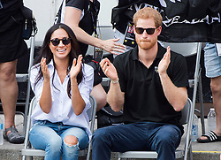 Prince Harry and his girlfriend Meghan Markle applaud at the wheelchair tennis competition at the Invictus Games in Toronto, ON, Canada, Monday September 25, 2017. This is Prince Harry's first public appearance with Markle. Photo by Nathan Denette/CP/ABACAPRESS.COM