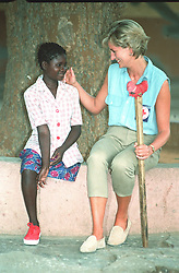 """Embargoed to 0001 Monday August 21 File photo dated 14/01/97 of Diana, Princess of Wales, with Sandra Tigica 13, at the orthopaedic workshop in Neves Mendinha, near Launda, Angola. Diana, Princess of Wales was a woman whose warmth, compassion and empathy for those she met earned her the description the """"people's princess""""."""