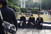 Visitors to the 59th All Kendo Championship waiting outside,  Budokan, Tokyo, Japan, November 3, 2011. Contestants from all over Japan compete doing the day-long event. Kendo is a popular martial art based on traditional Japanese swordsmanship.