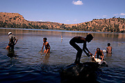 Villagers wash their animals in volcanic crater, Lake Hora at Debre Zeit, Ethiopia