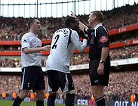 Photo: Olly Greenwood.<br />Arsenal v Tottenham Hotspur. The Barclays Premiership. 02/12/2006. Referee Graham Poll waves away Spurs Pascal Chimbonda's pleas not to give a penalty