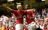 Photo: Richard Lane.Digitalsport<br /> Arsenal v Manchester United. FA Community Shield. 08/08/2004.<br /> Alan Smith celebrates his goal with David Bellion.