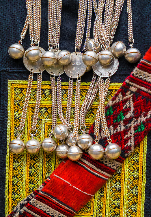 SAPA, VIETNAM - CIRCA SEPTEMBER 2014:  Detail of brocade and silvers from the Red Dao ethnic minority in the Village Ta Phin near Sapa, North Vietnam.