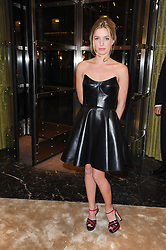 Actress ANNABELLE WALLIS at a Cocktail party to celebrate the opening of the new Miu Miu boutique, 150 New Bond Street, London hosted by Miuccia Prada and Patrizio Bertelli on 3rd December 2010.