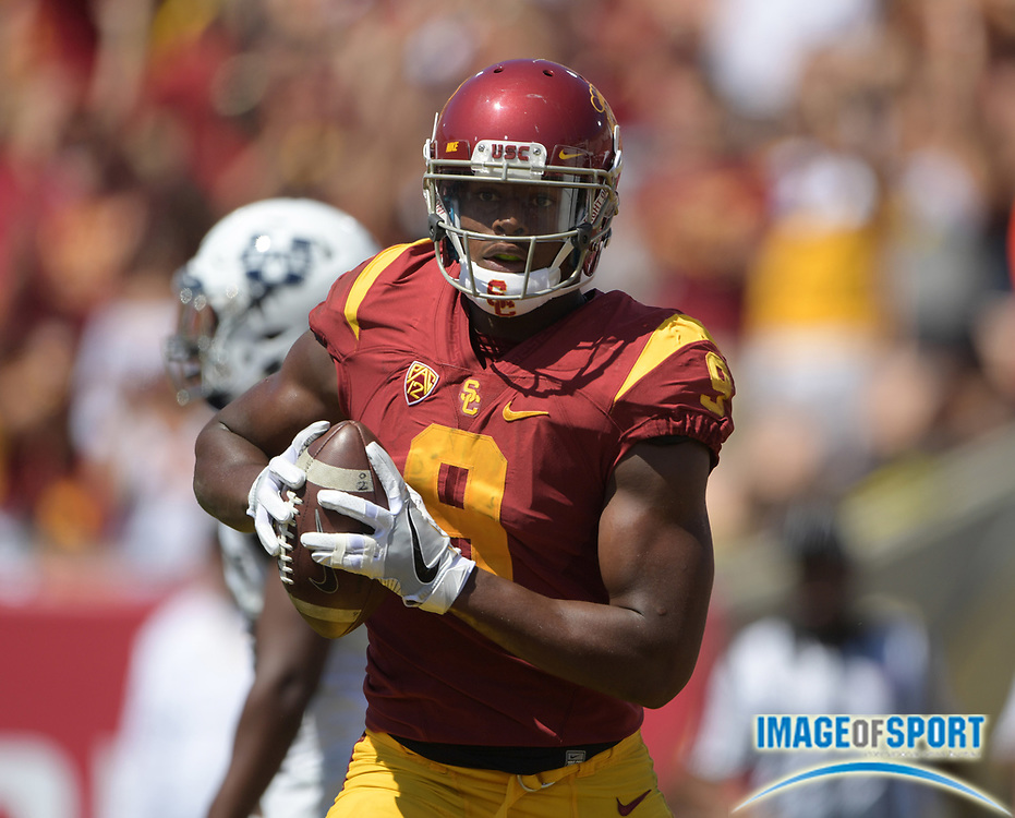 Sep 10, 2016; Los Angeles, CA, USA; USC Trojans receiver JuJu Smith-Schuster (9) celebrates after scoring a touchdown pass against the Utah State Aggies during a NCAA football game at Los Angeles Memorial Coliseum. USC defeated Utah State 45-7.