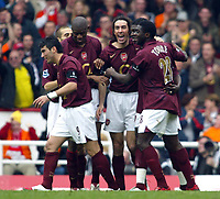 Photo: Chris Ratcliffe.<br />Arsenal v West Bromwich Albion. The Barclays Premiership. 15/04/2006.<br />Robert Pires of Arsenal celebrates his goal with his Arsenal team-mates