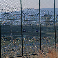 Razor wire and guard towers encircle Montana State Prison.