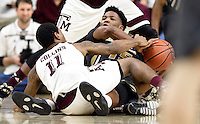 Missouri's Wes Clark (15) looks for a teammate while fighting off Texas A&M's Anthony Collins (11) for a loose ball during the second half of an NCAA college basketball game, Saturday, Jan. 23, 2016, in College Station, Texas.  Texas A&M won 66-53.  (AP Photo/Sam Craft)