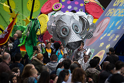 """© Licensed to London News Pictures . 14/06/2015 . Manchester , UK . Manchester Day parade and festival through Manchester City Centre . A """" games """" theme featuring costumes , floats and gigantic puppets , built by community groups over several months , features . Photo credit : Joel Goodman/LNP"""