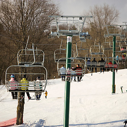 Riding the quad chairlift at the Quechee Ski Hill in Quechee, Vermont.