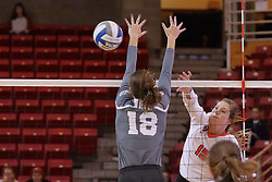 06 November 2015:  Ashley Rosch(15) strikes the ball past Allison Turner(18) during an NCAA women's volleyball match between the Bradley Braves and the Illinois State Redbirds at Redbird Arena in Normal IL (Photo by Alan Look)