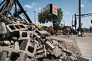 Rubble lines Minnehaha Avenue outside the destroyed Autozone building as residents and volunteers take to the street to assess the damage in Minneapolis, Minnesota on Monday, June 1, 2020. The auto parts store was damaged extensively during the civil unrest in the final days of May following the death of George Floyd at the hands of Minneapolis Police Department officers.