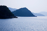 The Inland Sea separates Honshu, Shikoku and Kyushu three of the main islands of Japan.  3000 islands are located in the Inland Sea, including larger islands Awajishima and Shodoshima. Many of the smaller islands are uninhabited.
