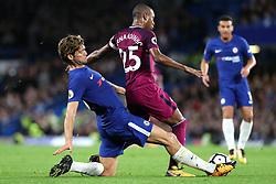 30 September 2017 - Premier League Football - Chelsea v Manchester City - Marcos Alonso of Chelsea stretches to intercept Fernandinho of Man City - Photo: Charlotte Wilson / Offside