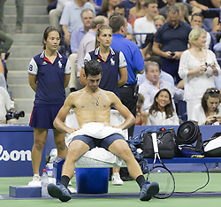 September 5, 2018 - New York, New York, United States - Novak Djokovic of Serbia cools off using ice, towel & portable fan during US Open 2018 quarterfinal match against John Millman of Australia at USTA Billie Jean King National Tennis Center (Credit Image: © Lev Radin/Pacific Press via ZUMA Wire)