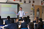 Teacher takes a history class at Pimlico Academy, a modern secondary school in London, UK. Students education here is based on aspiration and is a huge success story following a large scale conversion.