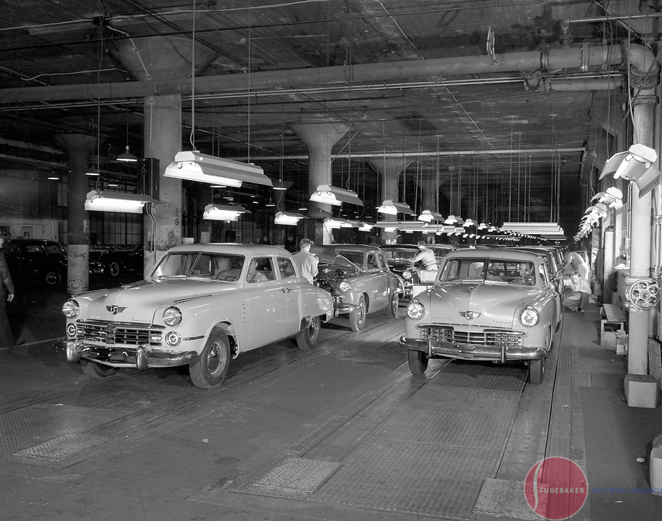 A 1949 Commander (l) and Champion (r) reach the end of assembly line.