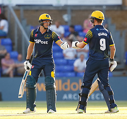 Glamorgan's Craig Meschede celebrates a boundary with team-mate Nick Selman<br /> <br /> Photographer Simon King/Replay Images<br /> <br /> Vitality Blast T20 - Round 8 - Glamorgan v Gloucestershire - Friday 3rd August 2018 - Sophia Gardens - Cardiff<br /> <br /> World Copyright © Replay Images . All rights reserved. info@replayimages.co.uk - http://replayimages.co.uk