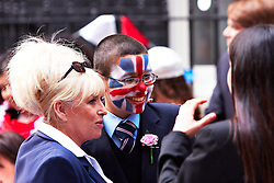 LONDON, UK  29/04/2011. The Royal Wedding of HRH Prince William to Kate Middleton. Prime minister David Cameron and his wife Samatha host a Royal Wedding Street Party outside Number 10 Downing Street. Young and old guests from a range of charities enjoyed cakes, party games including tug of war, catching water bombs and face painting (Mahdi Hadi from Pimlico Academy pictured center with his face painted with a union jack and Barbara Windsor right).  Photo credit should read CLIFF HIDE/LNP. Please see special instructions. © under license to London News Pictures