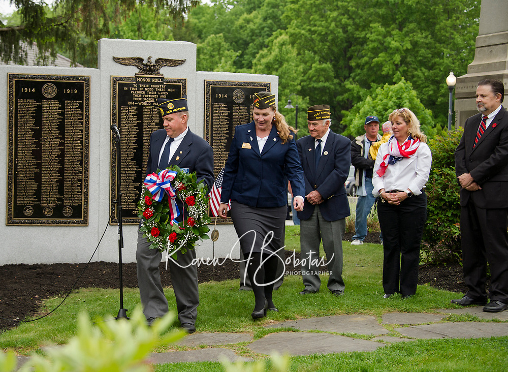 American Legion Post 1 Commander Raymond Peavey Jr., and Veteran's of Foreign Wars Post 1670 Vice Commander Hillary Seager present the wreath during Memorial Day ceremonies held at Veteran's Square on Monday morning.  (Karen Bobotas/for the Laconia Daily Sun)