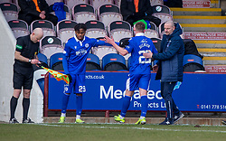 06MAR21 Queen of the South's Tommy Goss brings on Queen of the South's Adedapo Awokoya-Mebude. Arbroath 2 v 4 Queen of the South, Scottish Championship played 6/3/2021 at Arbroath's home ground, Gayfield Park.
