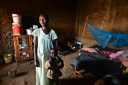 July 3, 2017 - Wau, Wau, South Sudan - LIBNA TUVUR, 37, a widow mother of seven stands with one of her children in one of the shelters in the st. Mary's Help of Christian Cathedral in Wau, South Sudan on Monday. Thousands of South Sudanese have found refuge within the grounds of the church since June 2016. (Credit Image: © Miguel Juarez Lugo via ZUMA Wire)