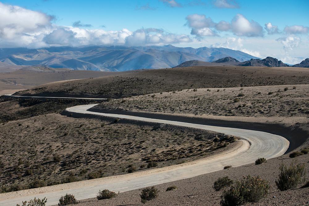 Road in park<br /> Chimborazo Volcano (Highest mountain in Ecuador) in distance<br /> Andes<br /> ECUADOR, South America
