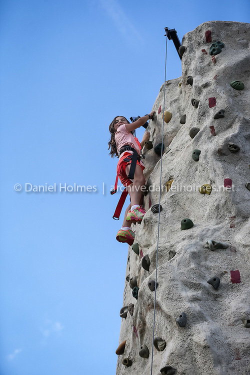 (8/27/16, SOUTHBOROUGH, MA) Lila Shields, 9, of Southborough makes it to the top of the rock wall during Southborough Summer Nights at the Neary School in Southborough on Saturday. Daily News and Wicked Local Photo/Dan Holmes