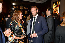 ALINE COQUELLE and COUNT RICCARDO LANZA at a party to celebrate the launch of the Maison Assouline Flagship Store at 196a Piccadilly, London on 28th October 2014.  During the evening Valentino signed copies of his new book - At The Emperor's Table.