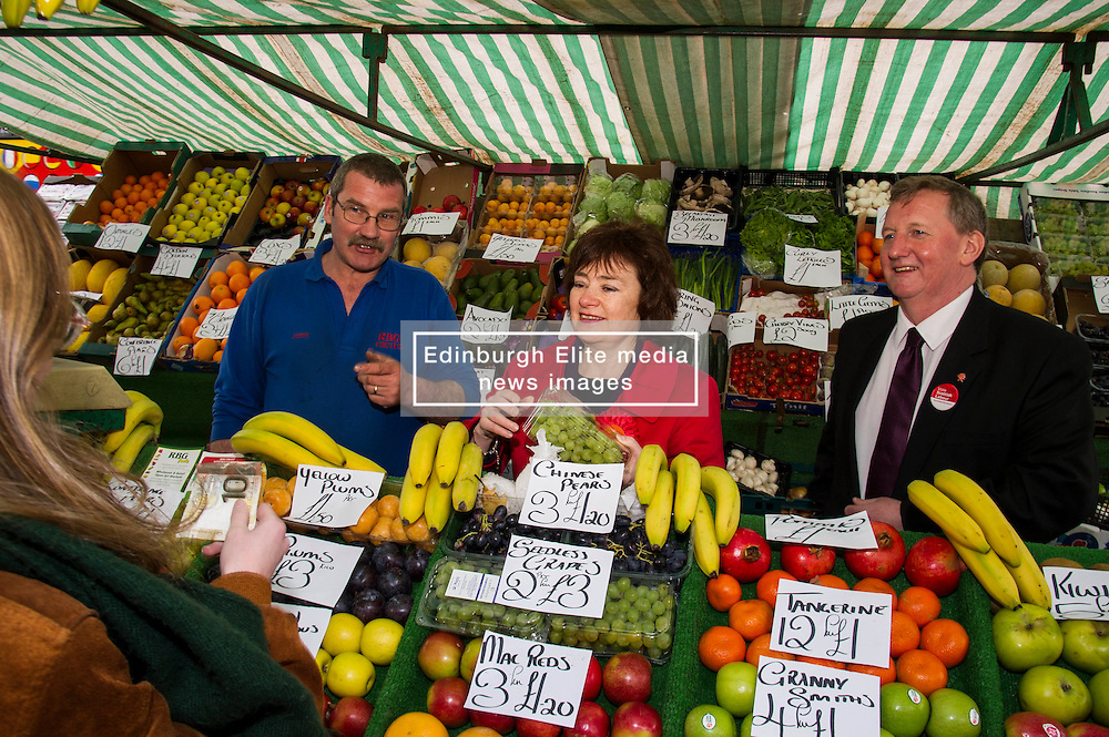 Pictured: John O'Connel of RBG fruits was keen to speak to Sarah Boyack and Alex Rowley<br /> <br /> Scottish Labour deputy leader Alex Rowley was joined by the party's environment spokeswoman Sarah Boyack and party activists at a farmers' market in the Grassmarket, Edinburgh today. <br /> <br /> Ger Harley   EEm 1 April 2016
