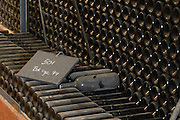 Piles of old bottles aging in the cellar, rouge red 1999 written on the chalk board Chateau Vannieres (Vannières) La Cadiere (Cadière) d'Azur Bandol Var Cote d'Azur France