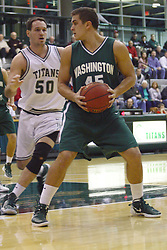 17 December 2011:  Alex Toth looks to get around Kevin Reed during an NCAA mens division 3 basketball game between the Washington University Bears and the Illinois Wesleyan Titans in Shirk Center, Bloomington IL