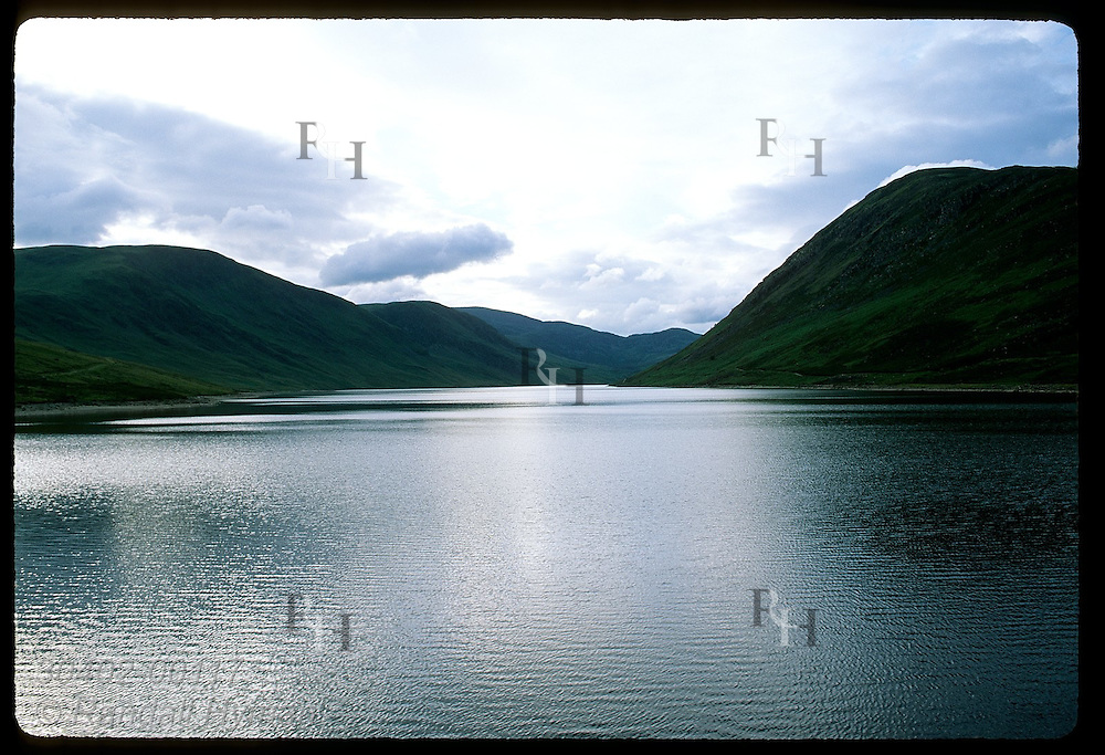 Loch Turret, water source for Glenturret Distillery, reflects a stormy summer sky; Crieff. Scotland