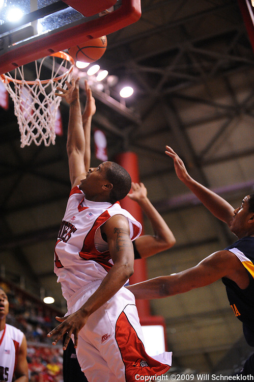 Feb 22, 2009; Piscataway, NJ, USA; Rutgers guard Mike Coburn (31) puts up a layup during the second half of Rutgers' 74-56 loss to West Virginia at the Louis Brown Athletic Center.