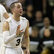 Central Florida guard A.J. Rompza (3) looks to the bench during a Conference USA NCAA basketball game between the Marshall Thundering Herd and the Central Florida Knights at the UCF Arena on January 5, 2011 in Orlando, Florida. Central Florida won the game 65-58 and extended their record to 14-0.  (AP Photo/Alex Menendez)