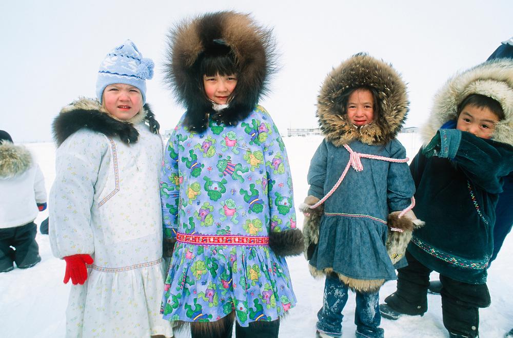 Barrow, Alaska. Children waiting for a sled ride during Piuraagiaqta - spring festival.