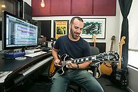 Shane Drasin demos some of his guitar licks used in radio spots at Benztown in Burbank, CA. Sept. 4, 2014. Photo by David Sprague