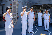 Miho Ootani, the first woman destroyer captain of Japan's Marine Self Defence Forces (MSDF), on board the Yamagiri in Yokosuka army base near Tokyo. Greeting visitors on their way out of the ship, together with other officers.