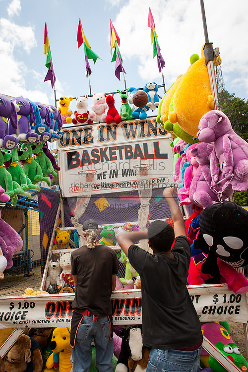 A young man shoots a basket ball in a carnival game at the World Grits Festival April 14, 2012 in St. George, SC. The festival celebrates the southern love for the sticky corn porridge