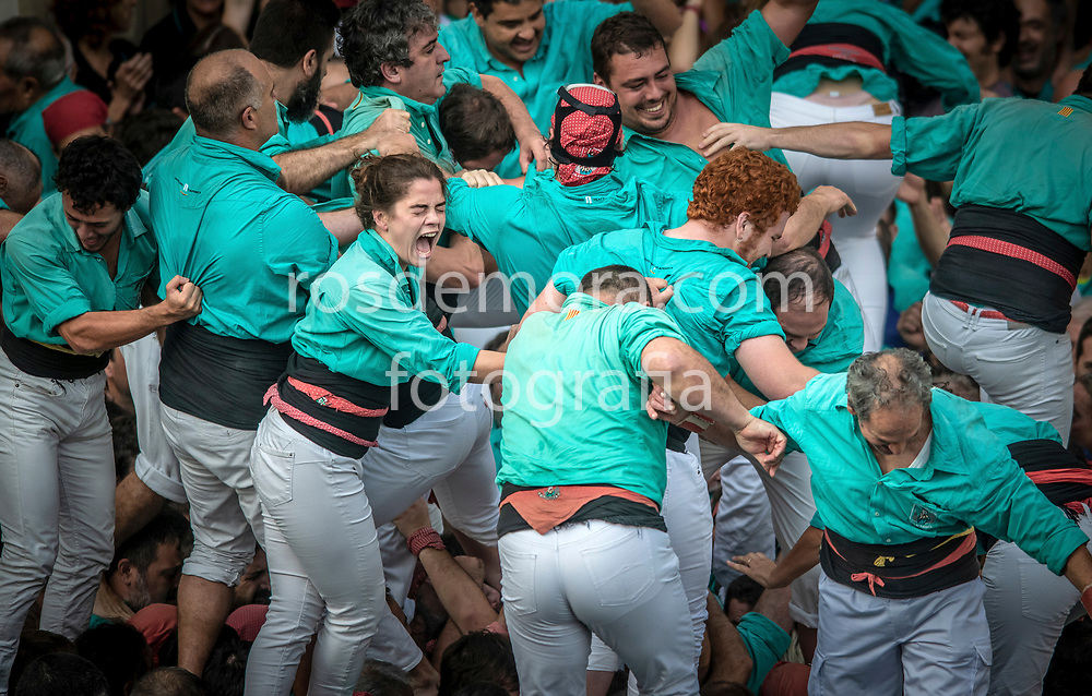 """Members of Castellers de Vilafranca celebrate having finished without falling the human tower """"3 of 10 fm"""", of extreme difficulty in the last performance of the season in Vilafranca del Penedès,Barcelona, Spain. 1st Nov 2019."""