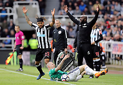 West Bromwich Albion's James McClean goes down as Newcastle United's DeAndre Yedlin (left) and West Bromwich Albion caretaker manager Darren Moore (right) appeal during the Premier League match at St James' Park, Newcastle.