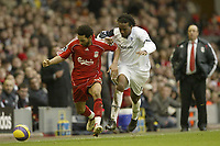 Photo: Aidan Ellis.<br /> Liverpool v Bolton Wanderers. The Barclays Premiership. 01/01/2007.<br /> Liverpool's Jermain Pennant (L) battles with Bolton's Ricardo Gardener