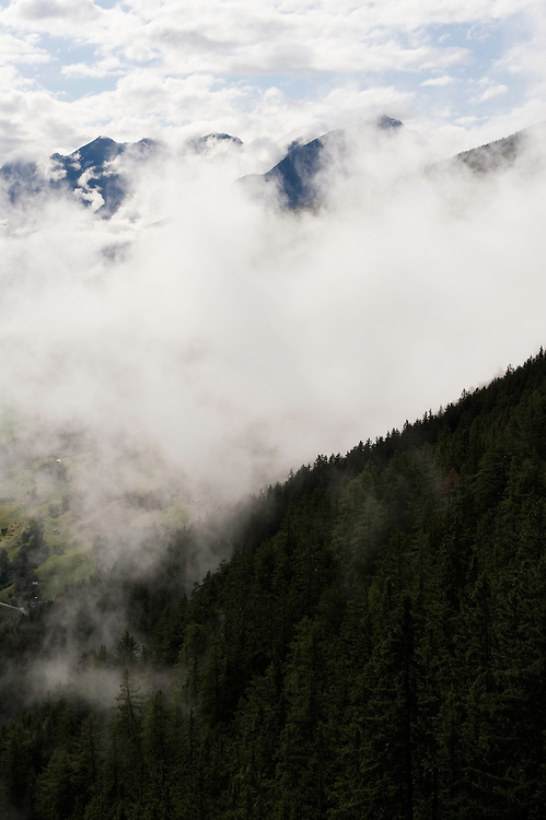 IFTE-NB-007642; Niall Benvie; panorama element; View into the valley around Fliess from Kaunergrat visitor's centre; Austria; Europe; Tirol; vertical; grey blue; forest woodland; 2008; July; summer; fog mist rain cloud; Wild Wonders of Europe Naturpark Kaunergrat