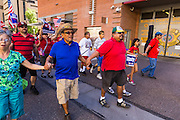 05 OCTOBER 2013 - PHOENIX, ARIZONA: People march past the Maricopa County Jail during an immigration reform march in Phoenix. The jail, and Maricopa County Sheriff Joe Arpaio, is a hot button topic for immigrants in Arizona because federal courts have found the sheriff guilty of racial profiling and discrimination. More than 1,000 people marched through downtown Phoenix Saturday to demonstrate for the DREAM Act and immigration reform. It was a part of the National Day of Dignity and Respect organized by the Action Network.  PHOTO BY JACK KURTZ
